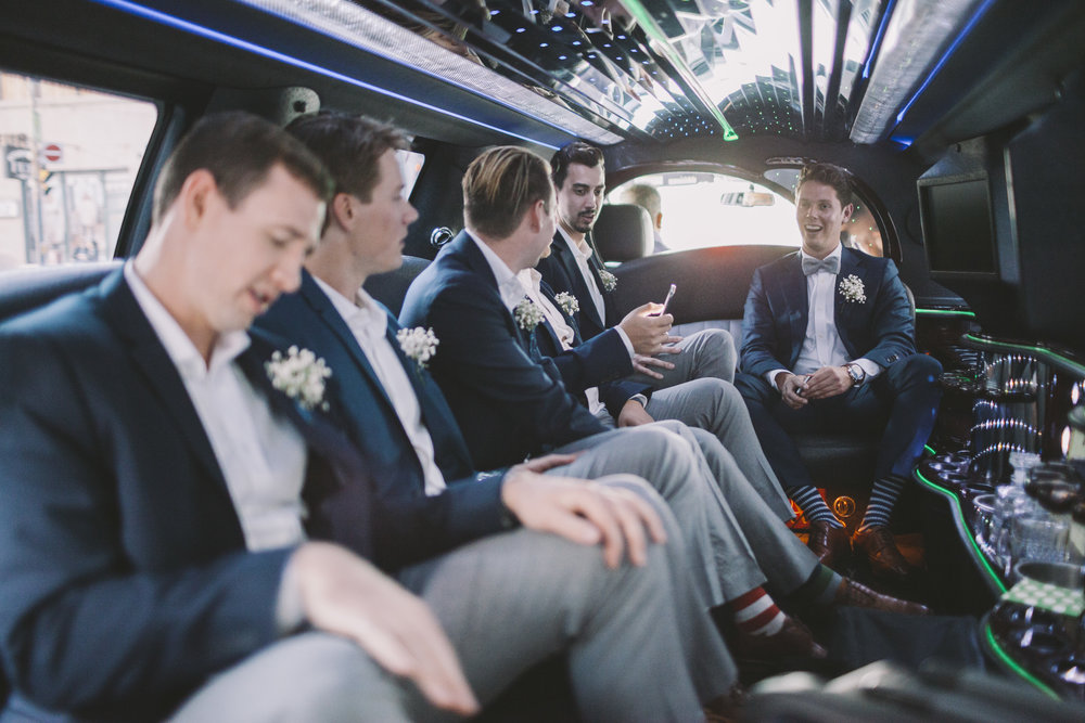 Groomsmen in the limo on the way to the wedding.