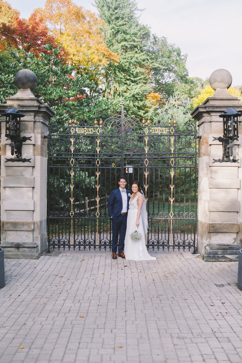 Bride and groom outside Craigleigh Gardens gate.