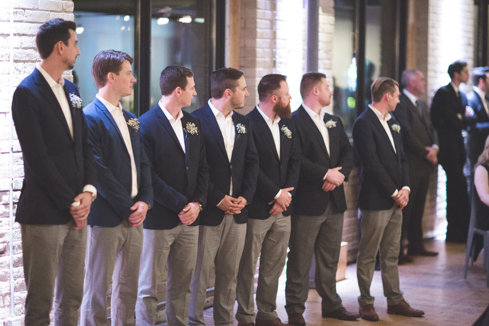 Groomsmen waiting for the bride.