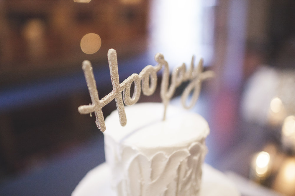 "elebratory cake with the word ""Hooray!"""