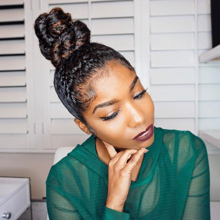 The Top Bun  - Buns are so easy, sleek and such a stylish way to keep natural hair cute on the job. Effortlessly go from morning meeting to office party with this versatile curly girl go to!