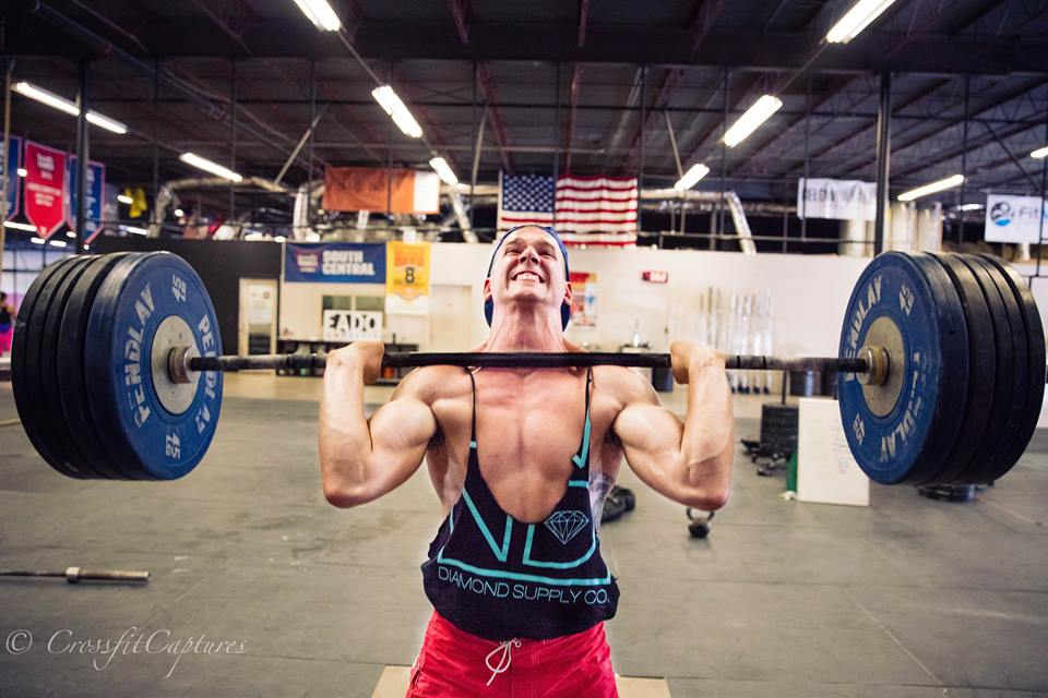 EaDo Elite athlete and Coach  Connor Martin doing yesterday's WOD and celebrating 80's day at CrossFit EaDo with an Arnold style tank     Photo Credit: Sierra Prime