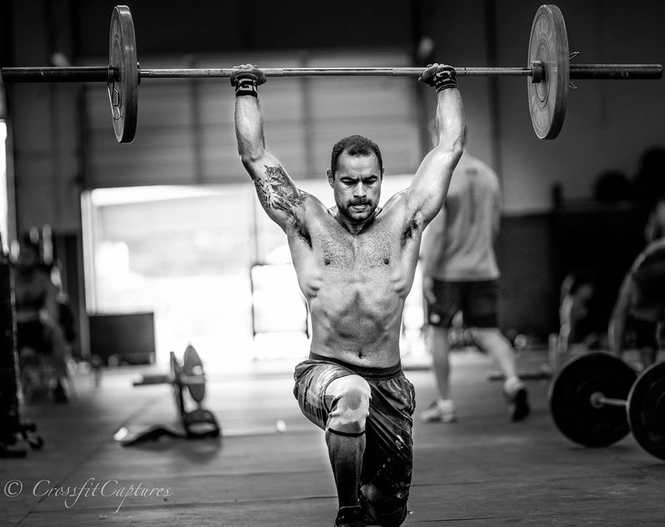 EaDo Elite Athlete Carlos doing overhead walking lunges.    Photo Credit: Sierra Prime