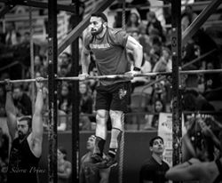 Dallas Henson Performing bar muscleups      Photo Credit: Sierra Prime