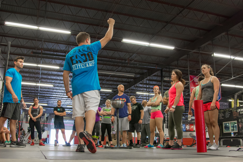 Photo of Jonathan Horton and RJ Heflin coaching the muscleup during the EaDo Elite Athlete Camp Photo Credit: Morteza Safataj