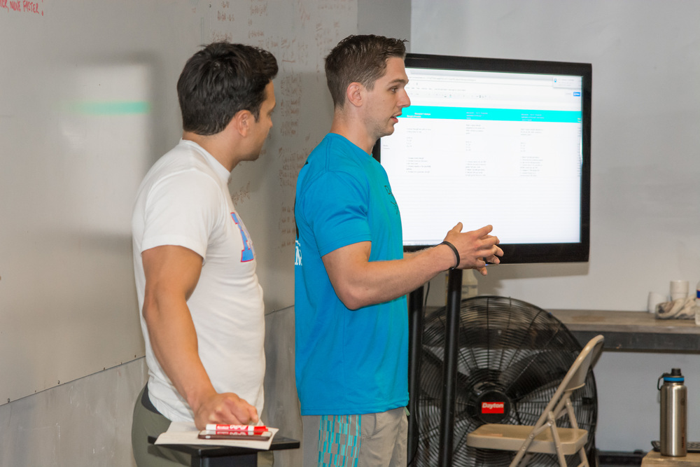 EaDo Elite Program Directors Shane Rojas and Connor Martin disucssing programming   Photo Credit: Morteza Safataj