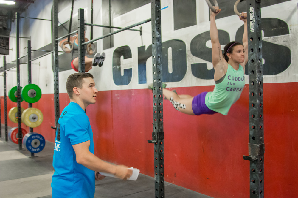 Coach Jonathan Horton working with Carrie Sabo on refining her muscleup technique   Photo Credit: Morteza Safataj