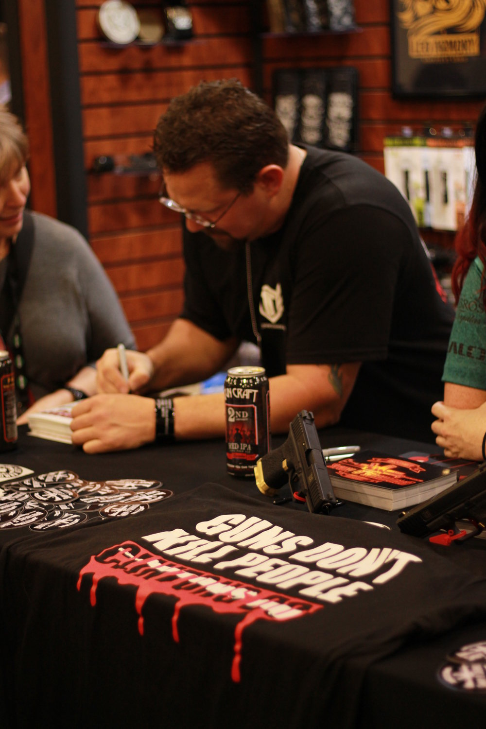"Tig signing with his ""Guns don't kill people, the Clinton's do"" shirt!"