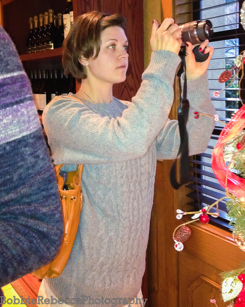 From 2012... I wonder if I can find an older one that shows me absorbed in the camera.  This was during a Christmas party at a winery.
