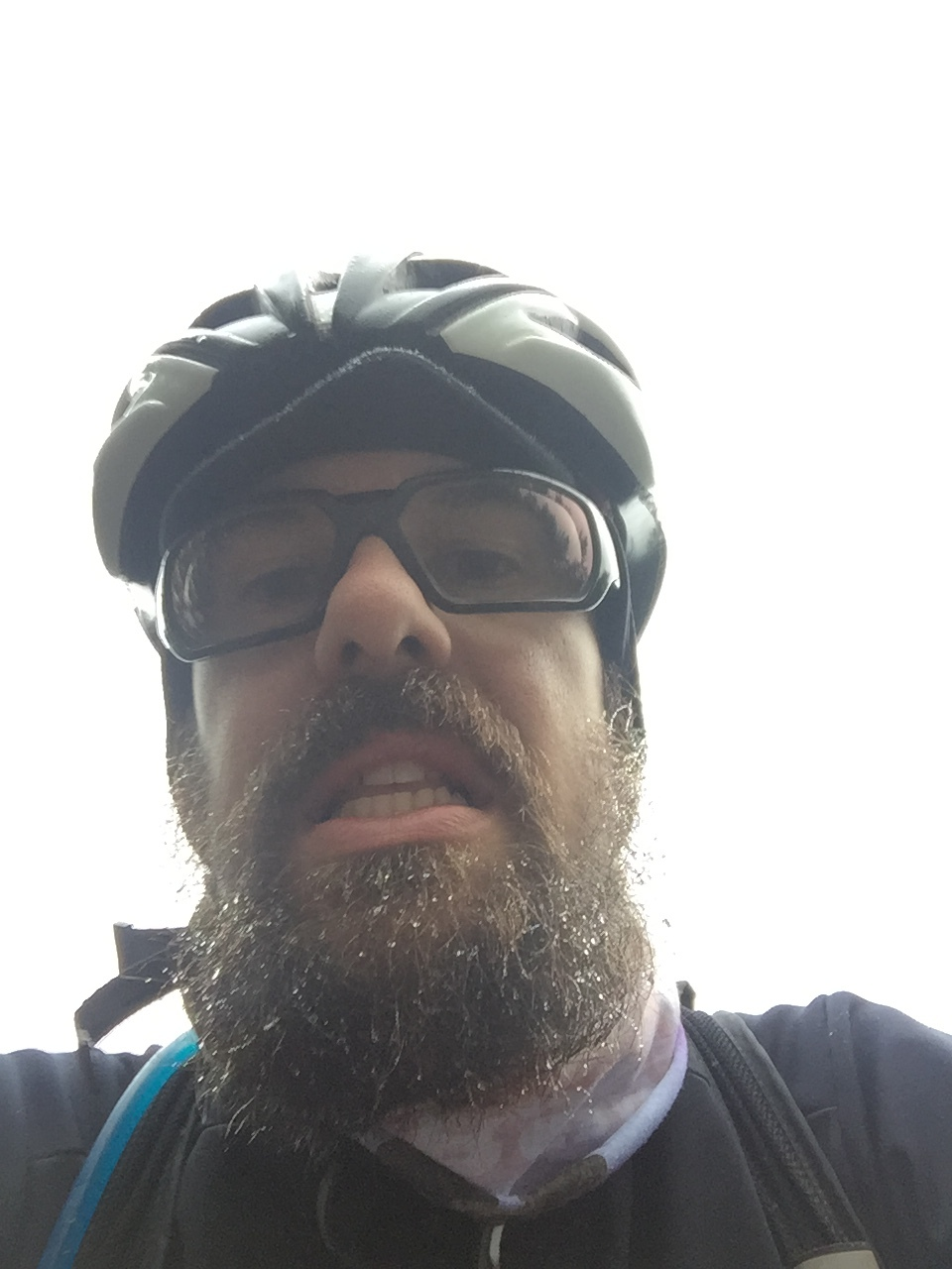 "My selfie attempt while riding my bike up a 9 mile paved climb. The visibility was maybe 30-40 feet. We were riding into a cloud and you can see the water accumulating on my beard. I would wear my Oklahoma ""winter"" riding gear all day. Boo hoo ;)"