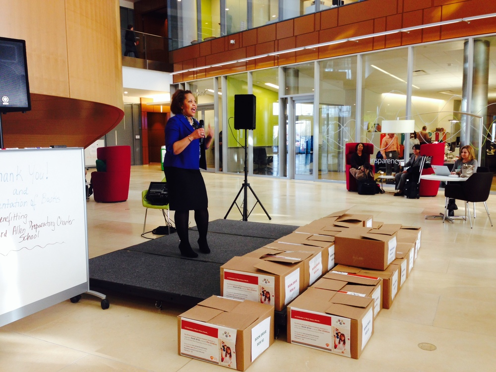 GSK's Ivy Peterson addresses and the books donated to RIchard Allen Preparatory Charter School