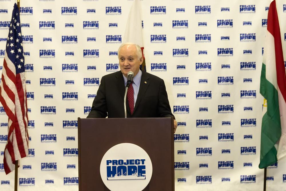 Dr. John P. Howe III at podium