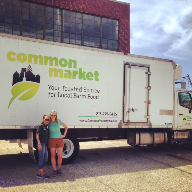 Nitza (left) and Erika (right) take time to capture the size difference between the truck operator and the truck.