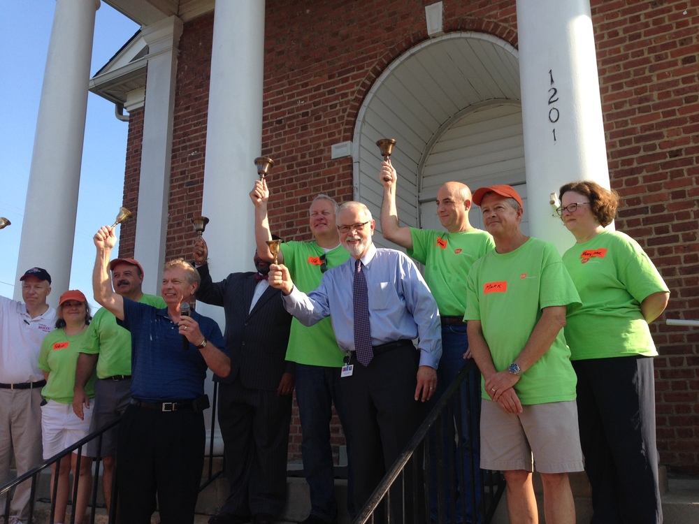 GlaxoSmithKline's Joe Touey (SVP North America Pharma IT) and Tom Scales (VP National Accounts) joined Dr. Bert L'Homme (Durham Public Schools Superintendent), Wendell Davis (Durham County Manage) and Ernie Mills (Durham Rescue Mission CEO) to ring the old school bells to mark the beginning of another school year and the day's events.