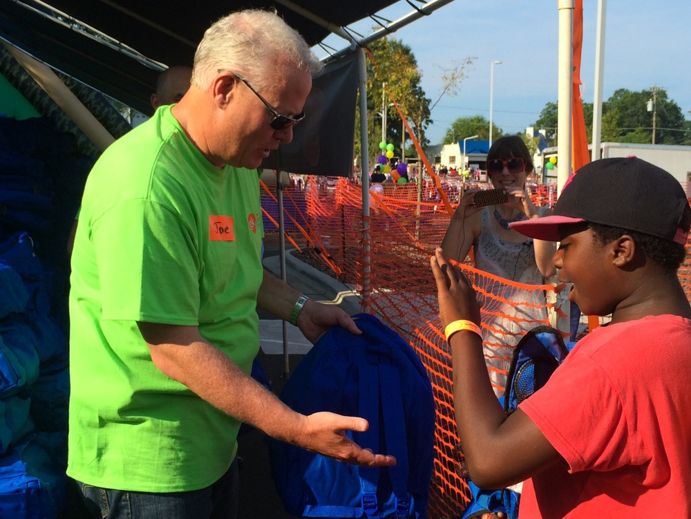GSK's Joe Touey gave out the first backpack of the day. Over 4,397 people were in attendance.