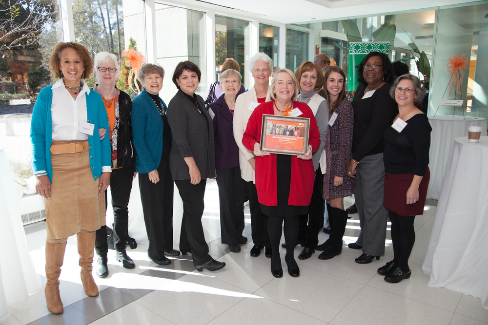 Carolyn Dickens (holding award),Presidentand ExecutiveDirector ofMotheread, joined teammates for a group shot after the ceremony.