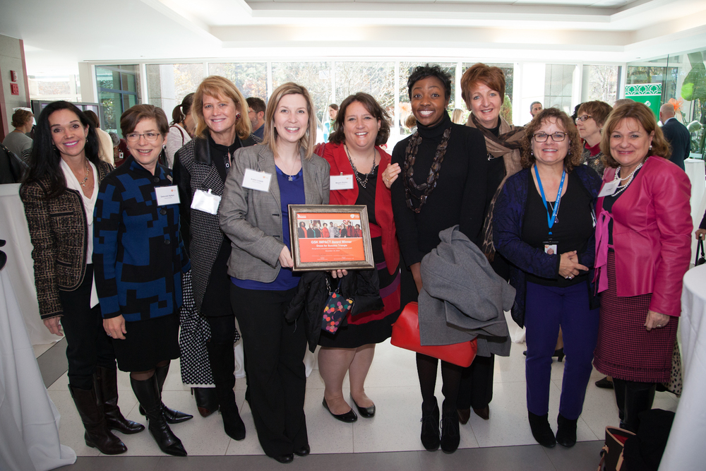 The team from Dress for Success gathered for a group shot in the atrium after the awards.