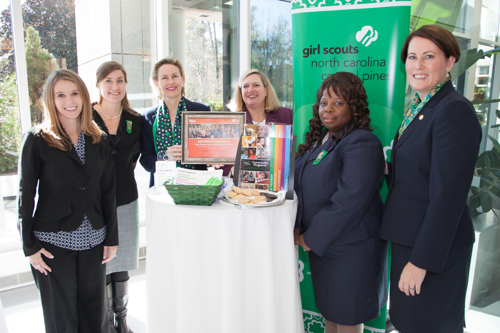 Lisa Jones (right),CEO ofthe Girls Scouts Northern Coastal Pines, joined team membersto show off their award and talk to GSK employees about volunteer opportunities.