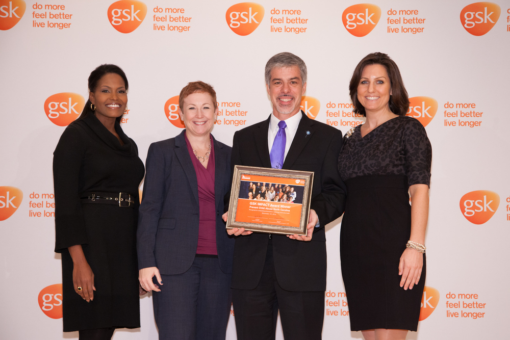 Bud Lavery,President and CEO ofPrevent Child Abuse North Carolina, accepts the award on behalf of the nonprofit.