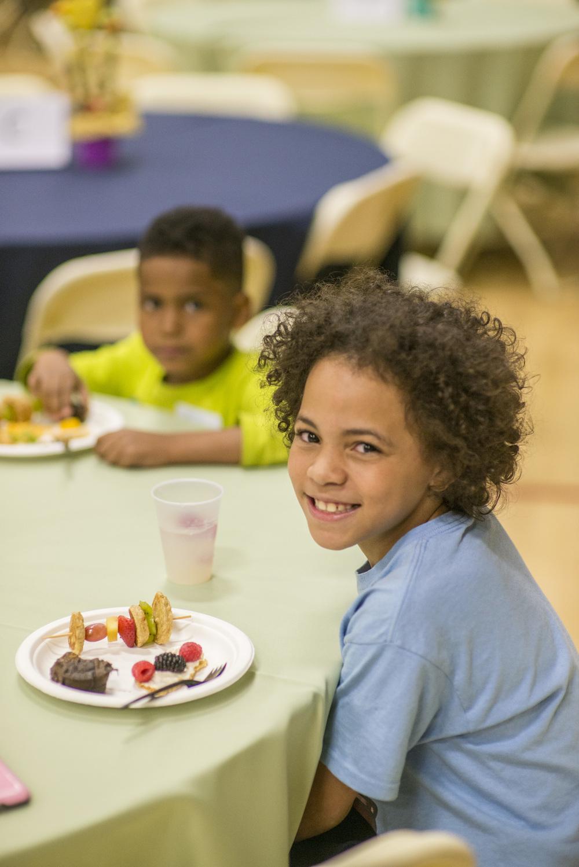 Neighborhood kids enjoying healthy snacks.