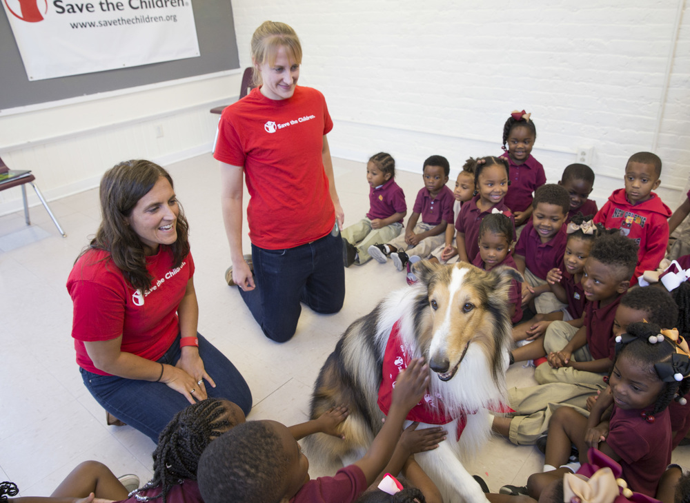 At a Save the Children Prep Rally in New Orleans, pre-schoolers petted Lassie the dog during a story time discussion about what makes them feel safe.