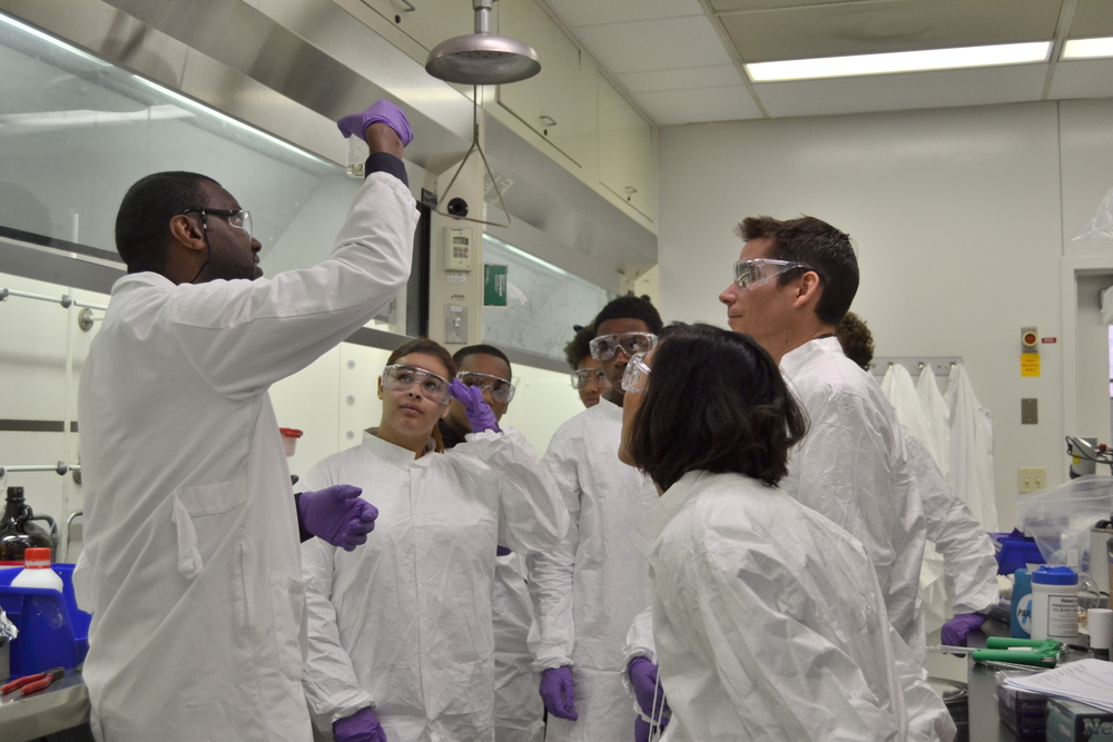 Lamont Terrell, one of our Medicinal Chemistry scientists, explains the experiment that these students are about to conduct.