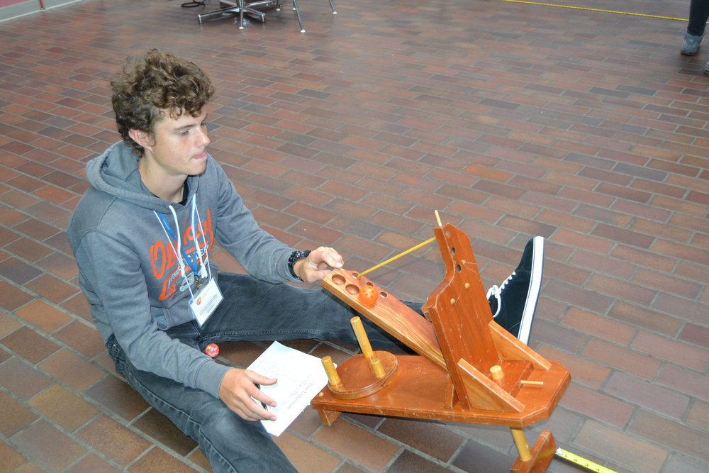 Did you know mathematicians can do work in research too? Here a student learns about Biostatistics through a catapult demonstration.