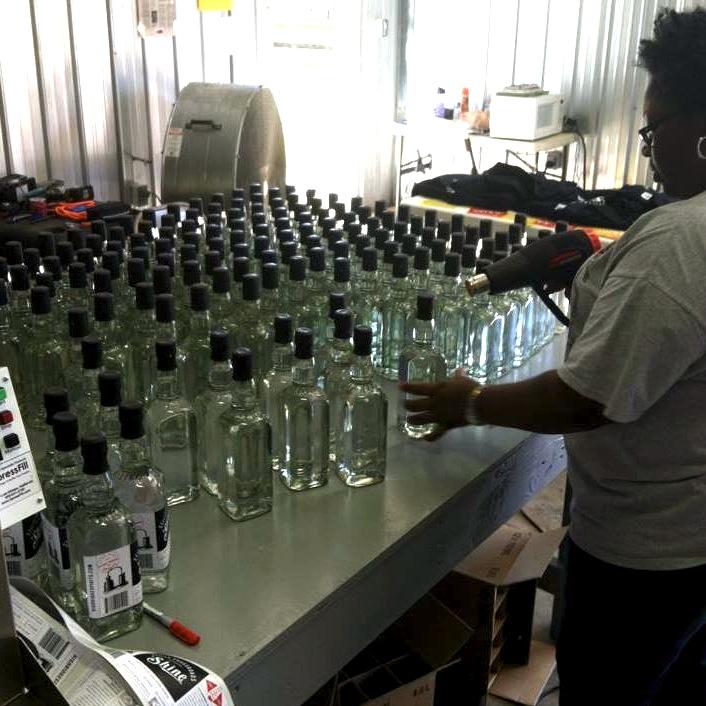 The High Ridge Spirits team bottling Batch 1 of Stills Crossroads Alabama 'Shine