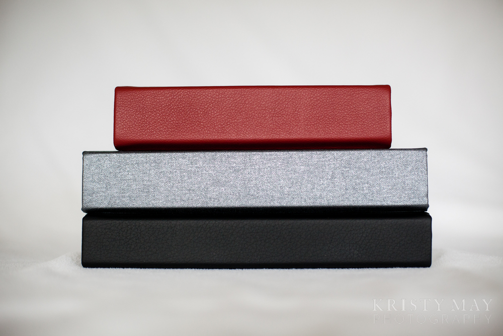 Red leather, gunmetal buckram and black classic leather
