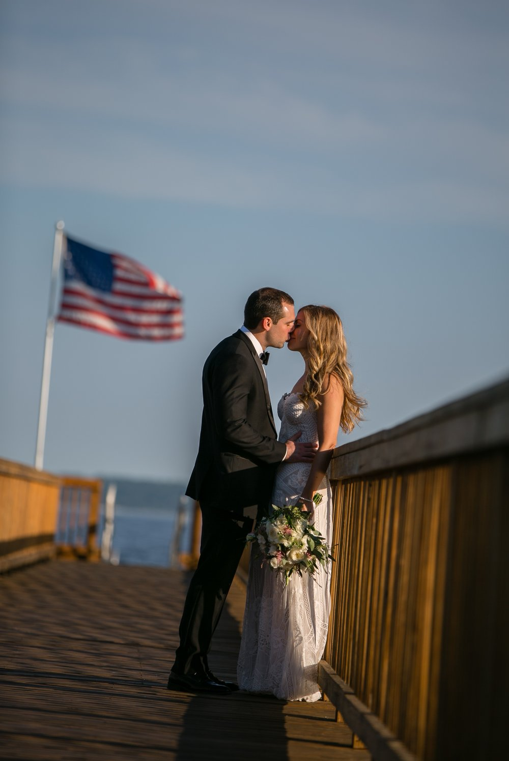 Wedding portraits on pier at Coveleigh Club in Rye, New York