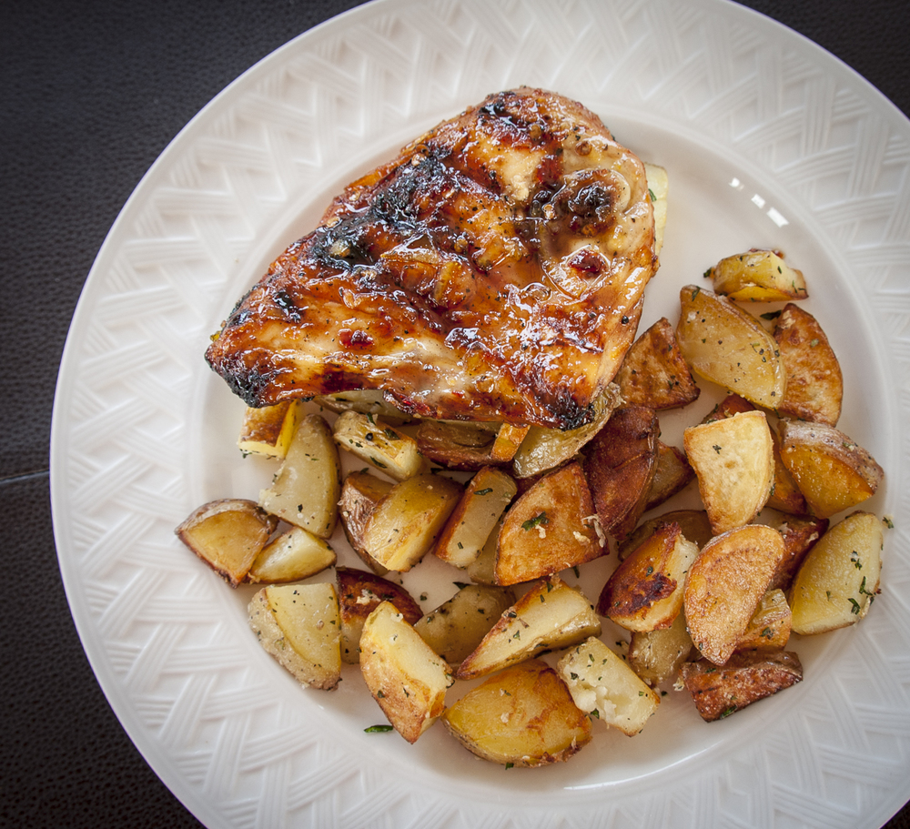 An all brown but tasty dinner of Orange Ginger Chicken and Rosemary Garlic Potatoes