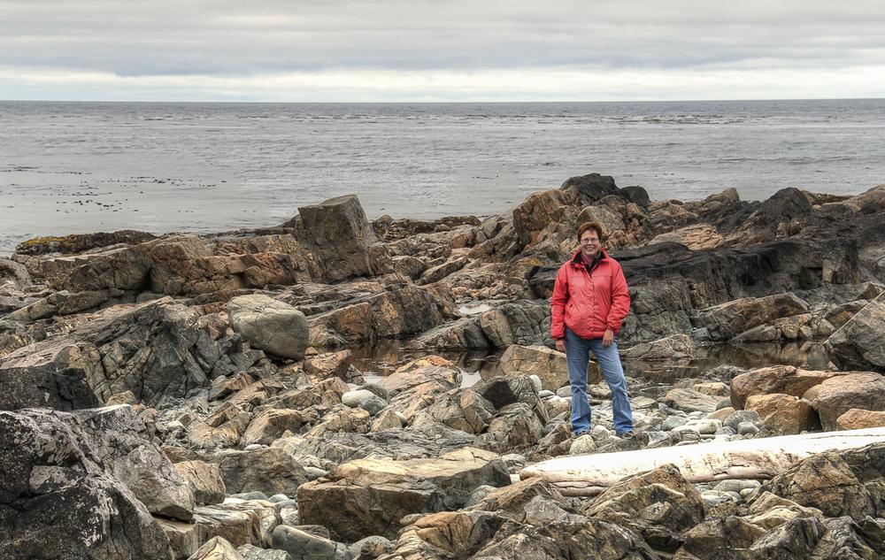 Karen exploring the rocks
