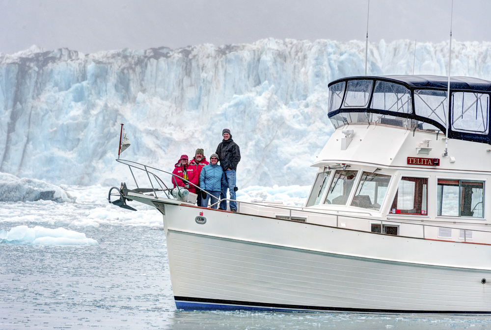 The crew of  Telita  bundled up in front of the Columbia Glacier