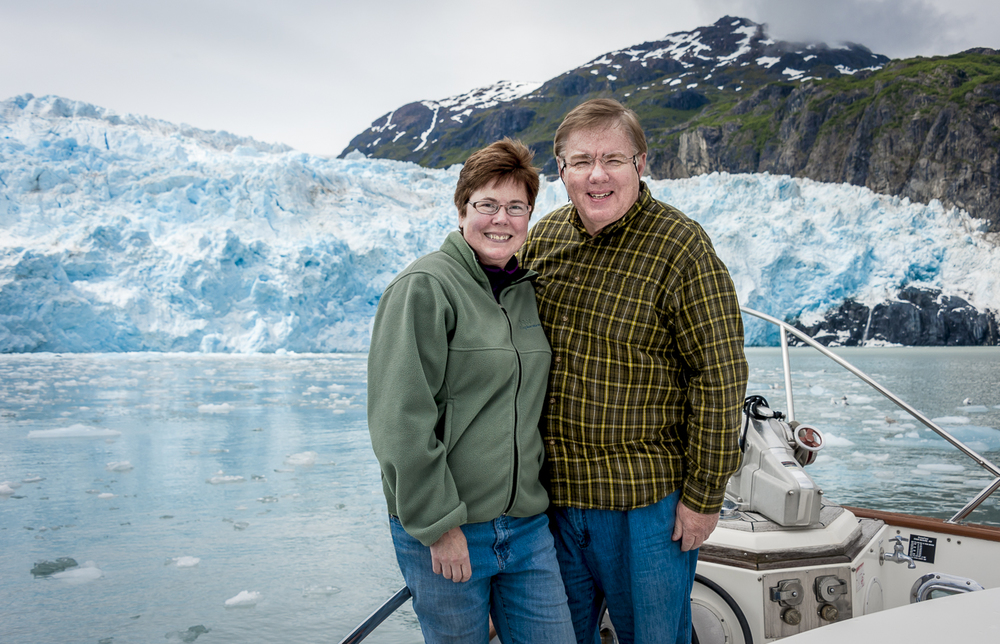 "Karen and Bob pose for a ""selfie"" in front of the  Chenega Glacier"