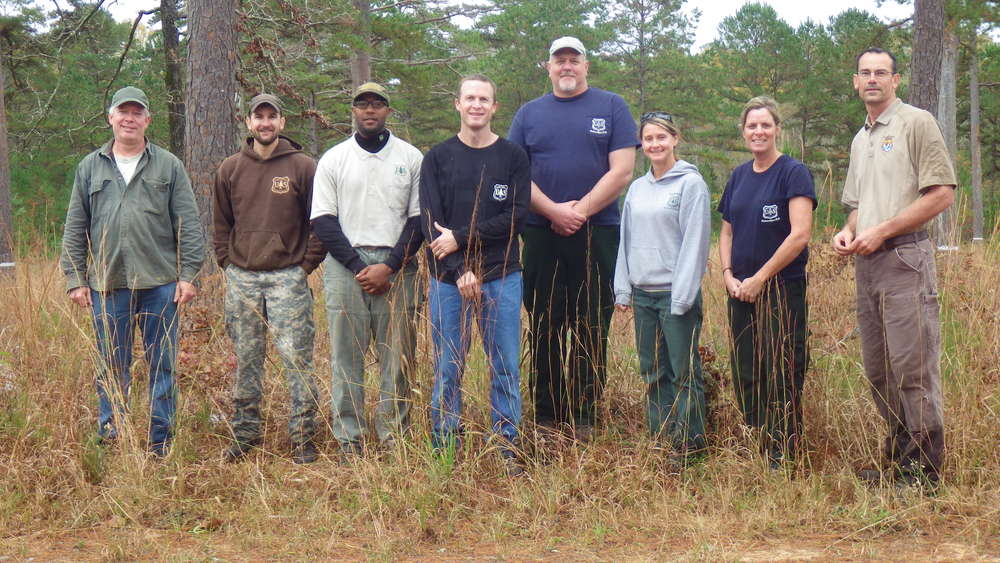 December 2015: Mark Bailey of Conservation Southeast (left) and Eric Spadgenske of USFWS (right) with the fantastic crew of U.S. Forest Service biologists who installed a total of 48 artificial cavities to maintain nesting and roosting habitat for the red-cockaded woodpecker at Sehoy and Enon plantations in Bullock County, AL.  We had folks from Bankhead, Conecuh, Talladega, Shoal Creek, and Oakmulgee with full support of their home districts and State Office. In less than a decade this RCW population has expanded from 4 to 30 groups, fledging 49 young in 2014.