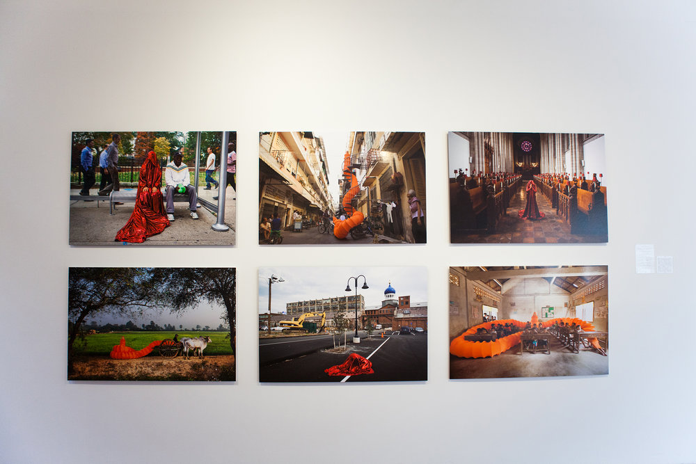 "Installation view of Anida Yoeu Ali's ""Red Chador"" series"
