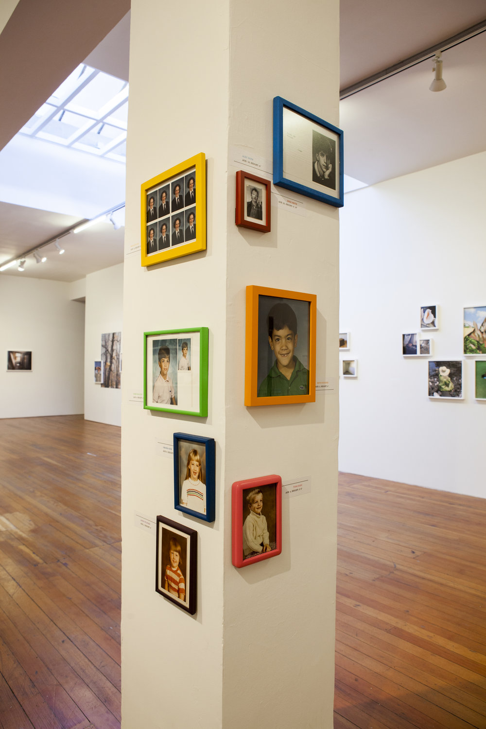 Installation view of artists school portraits.