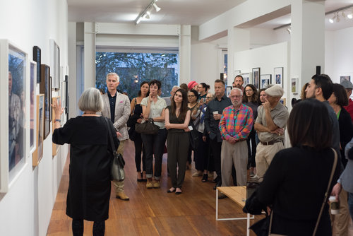 Sandra Phillips leads visitors through the 2018 Auction Exhibition