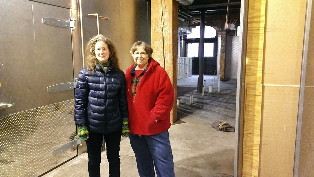 Board Directors Mary Moody and Karla Braig (l to r) standing on some newly cured cement.