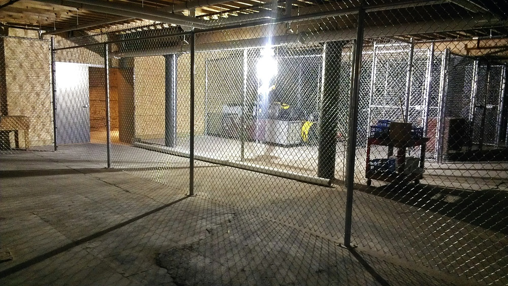 The downstairs area has quickly seen the construction of new fenced storage areas.