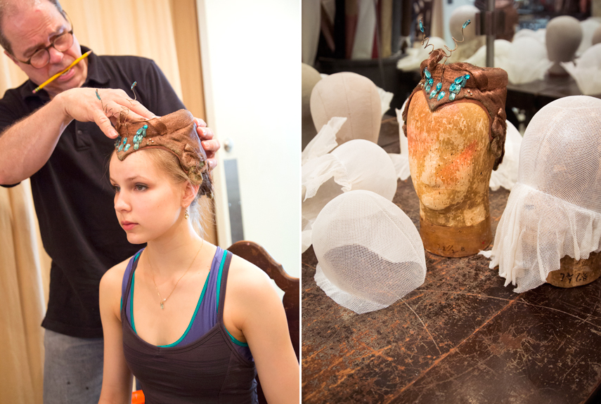 A dancer is getting fitted for an intricate headpiece
