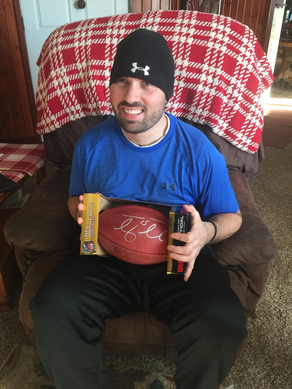 Travis today (2017) holding one of his favorite collectibles, autographed football by Tim Tebow.
