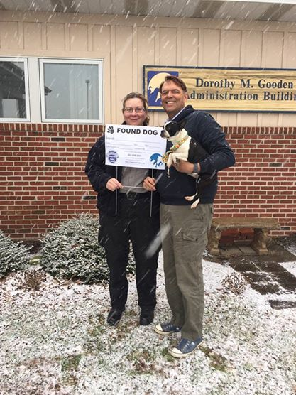 DEACC's Captain Sherri Warburton and FSAC-SPCA Executive Director Kevin Usilton pose with new Found Dog sign, with a friend from the Shelter.