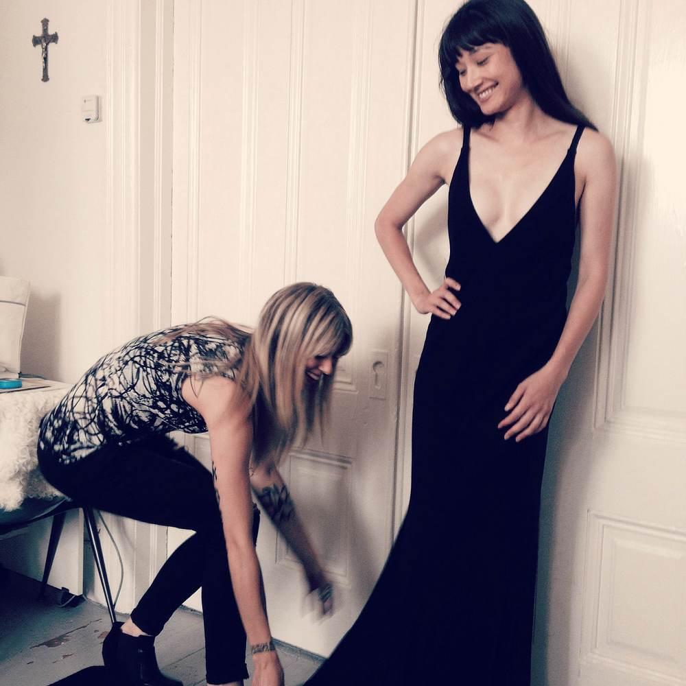 Melissa Fleis fitting a model in the Deep Dress