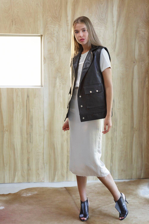 Melissa Fleis Leather Vest & White Skirt1.jpg