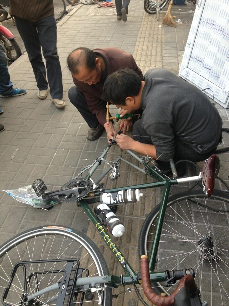 Welders working on my bike