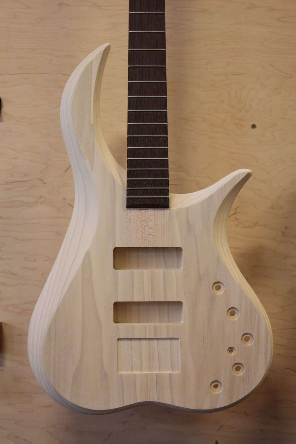 #028 Poplar Caracal 4 with 3 piece maple neck and wenge fretboard. Finish color yet to be determined.