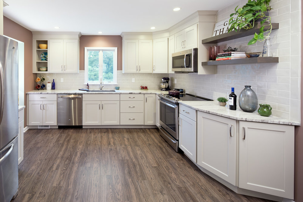 The kitchen was remodeled to provide a more open space. The refrigerator was moved to the opposite wall to allow easier access from the garage entry.