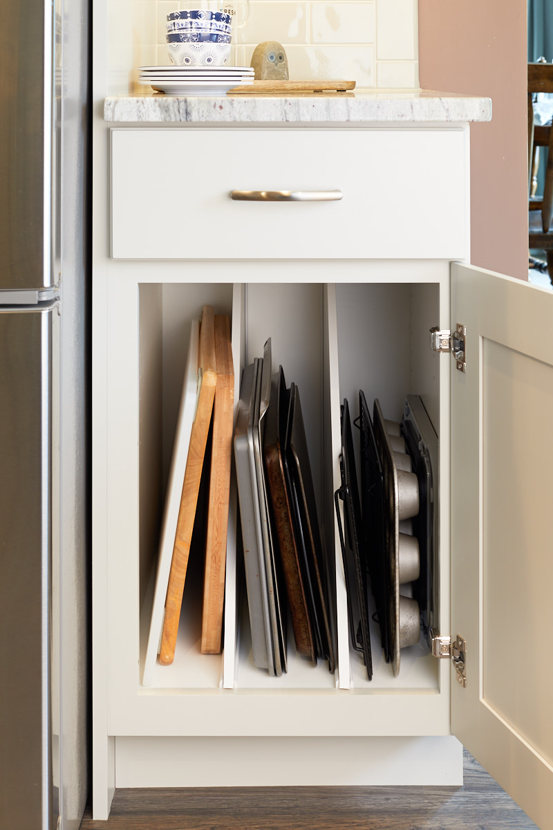 Dividers keep the cabinet organized and provide easy access to the items inside.