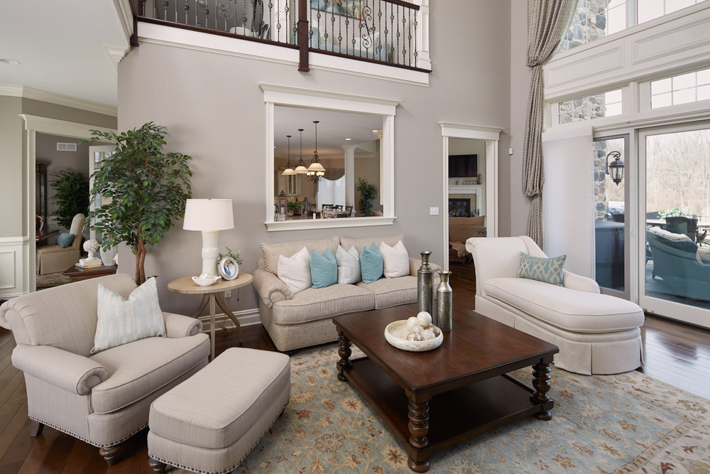 A beautifully designed, spacious living room is the first thing you see when entering the home from the front door.